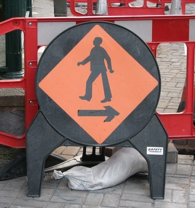 Stan Carey - moonwalking man on construction sign