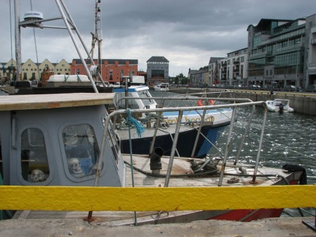 Stan Carey - skulls in boat in The Docks, Galway