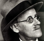 Close-up of James Joyce, facing right, in hat and glasses