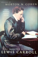 Book cover of The Selected Letters of Lewis Carroll, edited by Morton N. Cohen, featuring a colour photo of Carroll seated at his desk, facing right, holding a pen above a notebook and pages