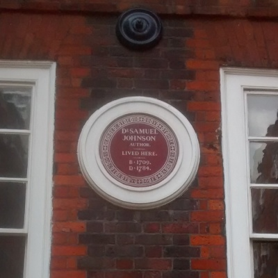 Circular plaque on the red-brick wall of 17 Gough Square. The plaque reads: