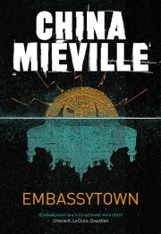 Pan Macmillan edition of 'Embassytown': a black cover with white line across the middle; above, an orange dome; below, a blue, spaceship-like underbelly