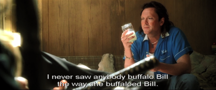 "Image from ""Kill Bill 2"": Michael Madsen, in blue shirt and mullet, sits on an old couch looking pensively at a drink he holds, and says: ""I never saw anybody buffalo Bill the way she buffaloed Bill."""