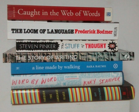 Photo of a stack of seven books, their spines facing front, and arranged to make a found poem, as presented in text below