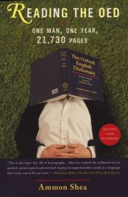 "Book cover of ""Reading the OED: One Man, One Year, 21,730 Pages"". The cover shows a man lying on his back on the grass with his hands crossed on his belly and a volume of the OED open on his face. He's probably asleep."
