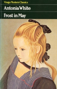 """The top quarter of the book cover is dark green, with the text """"Virago Modern Classics"""" in yellow, then, in larger white text, the author's name and the book title. Below them is a detail from Adolf Dietrich's painting """"Mädchen mit Schürze"""", showing a young girl in three-quarter profile, with fair hair tied back with a black bow. She faces left and has an expression that could be either concentrating or absent-minded."""