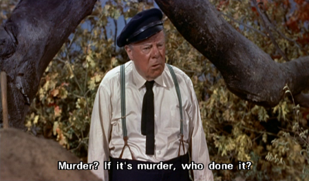 """Edmund Gwenn stands beneath a large tree branch, with leaves covering the space behind it. He wears a black sailing cap, a dark tie, a white shirt and suspenders, and says, """"Murder? If it's murder, who done it?"""""""